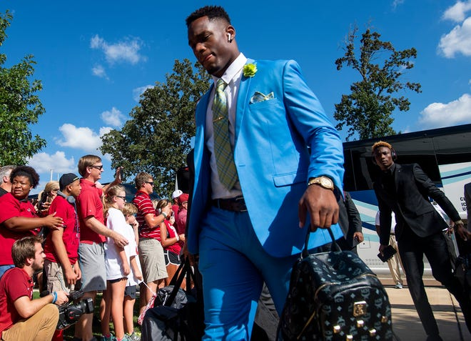 Alabama linebacker Mack Wilson (30) and Alabama wide receiver Henry Ruggs, III, (11), background, as the Alabama football team arrives on the Ole Miss campus in Oxford, Ms., on Saturday September 15, 2018.
