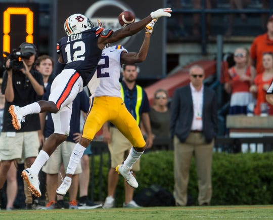 Auburn's Jamel Dean (12) is called for pass interference on LSU's Justin Jefferson (2) at Jordan-Hare Stadium in Auburn, Ala., on Saturday, Sept. 15, 2018. LSU defeated Auburn 22-21. The penalty set up the game winning field goal.