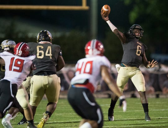 Wetumpka's TyQuan Rawls (6) passes the ball down the field against Opelika at Hohenberg Field in Wetumpka, Ala., on Friday, Sept. 14, 2018. Opelika leads Wetumpka 22-13 at halftime.