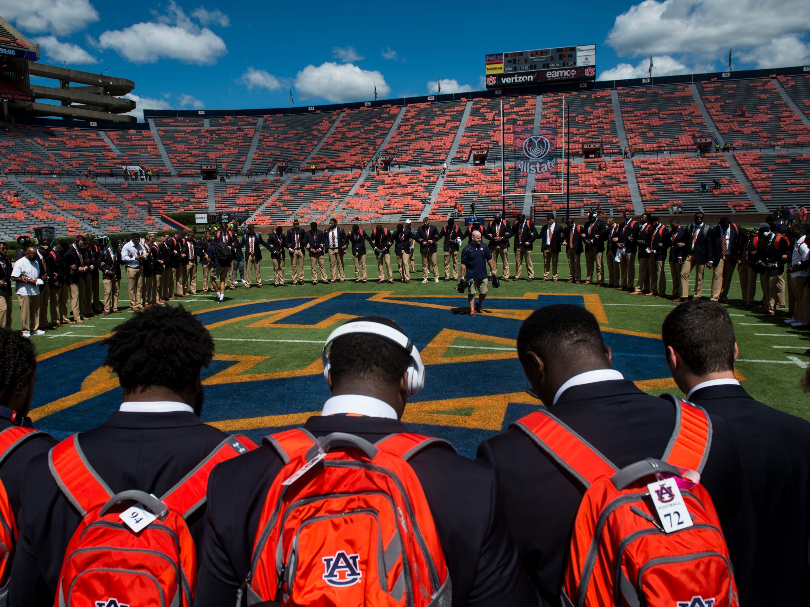 Auburn players huddle on the field before taking on LSU after the Tiger Walk at Jordan-Hare Stadium in Auburn, Ala., on Saturday, Sept. 15, 2018.