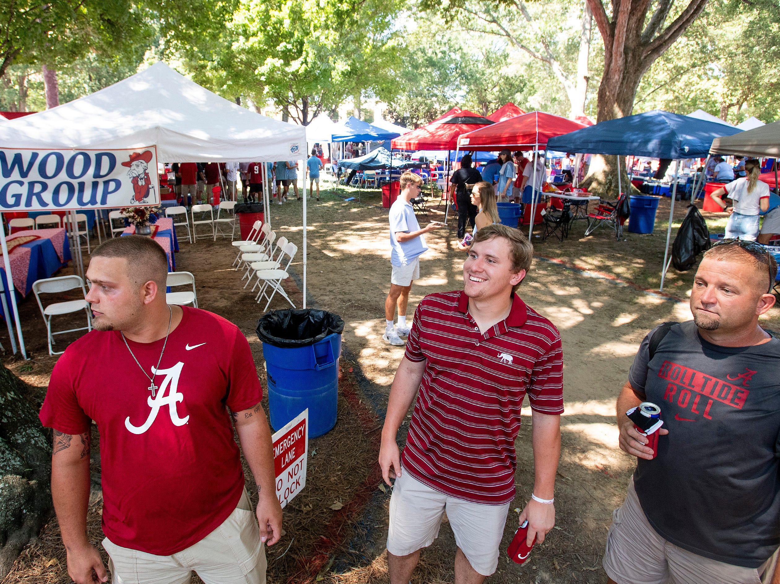Alabama fans, from left, Chance Borden, Tyler Robb and Steven Borden make their way through the Grove before the Alabama vs. Ole Miss game on the Ole Miss campus in Oxford, Ms., on Saturday September 15, 2018.