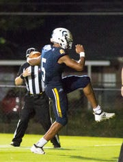 St. James' Collin Duncan celebrates his touchdown against Montgomery Academy.