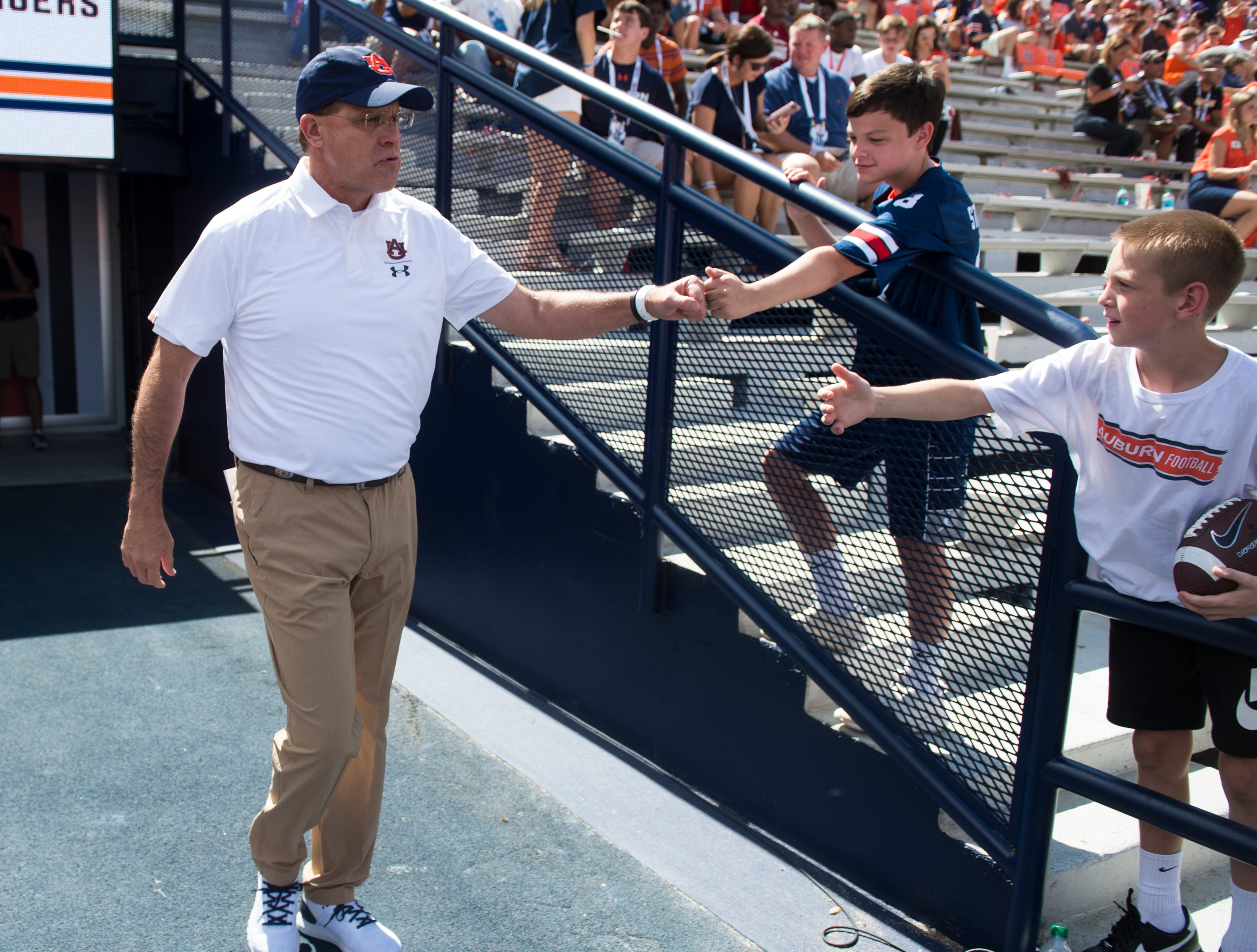 Auburn head coach Gus Malzahn walks on to the field for warm ups before Auburn takes on LSU at Jordan-Hare Stadium in Auburn, Ala., on Saturday, Sept. 15, 2018.