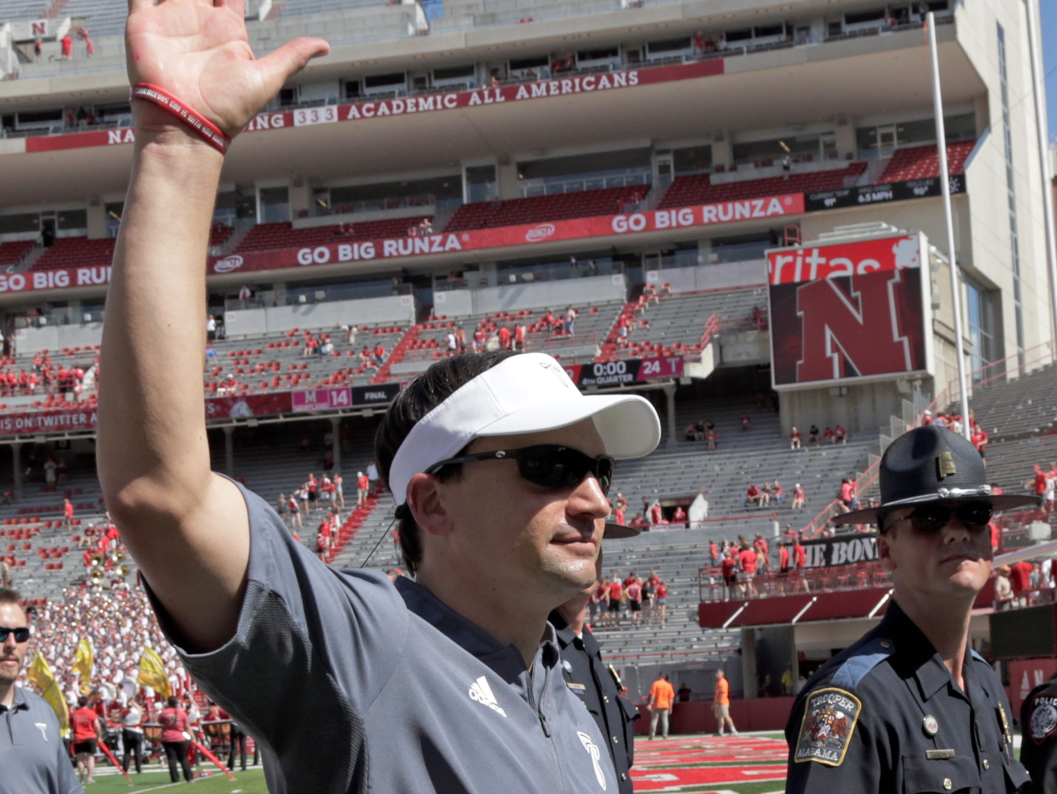 Troy head coach Neal Brown waves to fans as he leaves the field following an NCAA college football game against Nebraska in Lincoln, Neb., Saturday, Sept. 15, 2018. Troy won 24-19. (AP Photo/Nati Harnik)