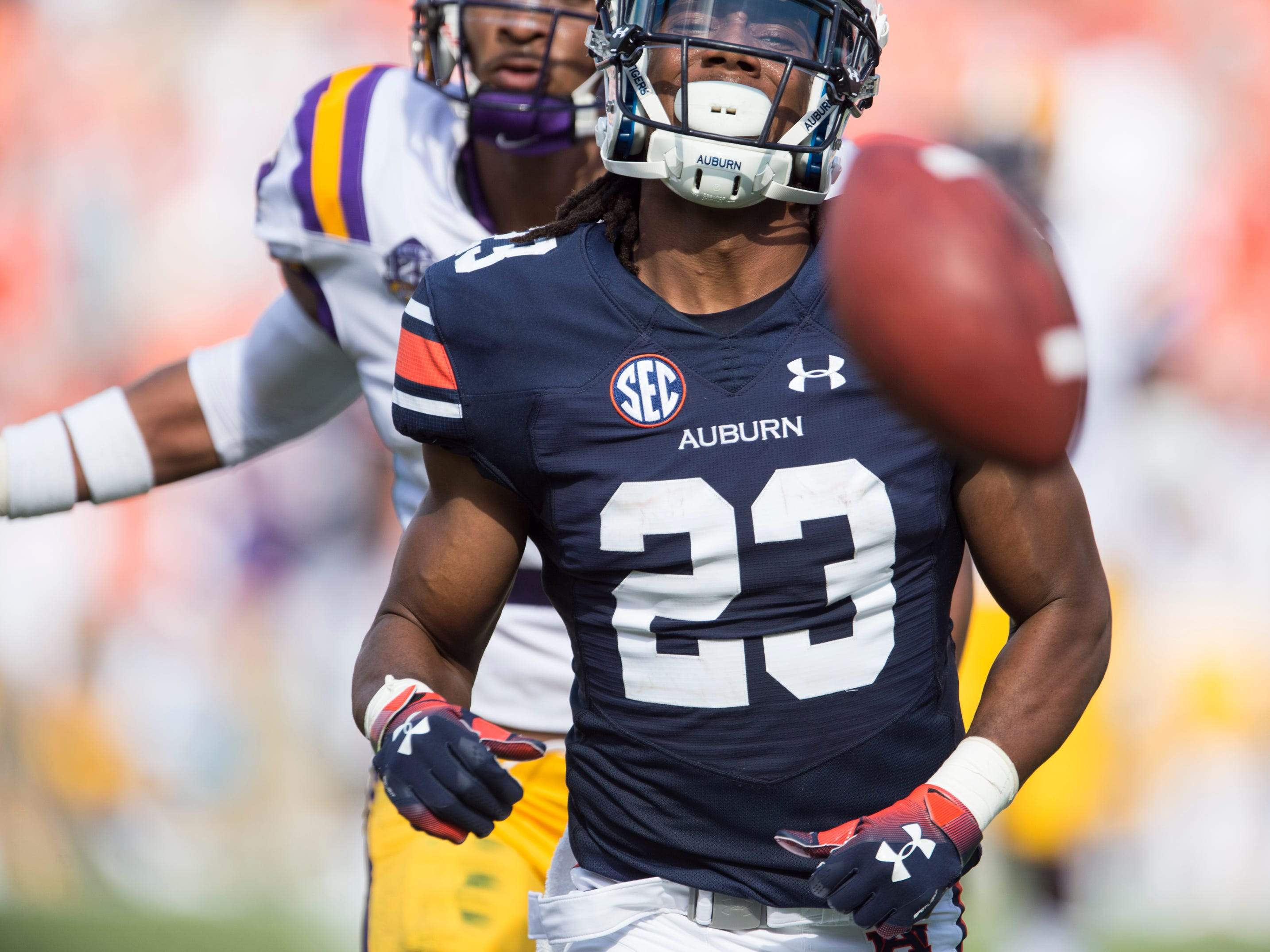 -Auburn's Ryan Davis (23) watches as an overthrow ball bounces in front of him at Jordan-Hare Stadium in Auburn, Ala., on Saturday, Sept. 15, 2018. Auburn leads LSU 14-10 at halftime.