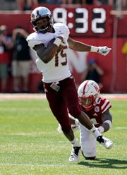 Troy wide receiver Damion Willis (15) runs away from Nebraska defensive back Lamar Jackson (21) during the first half of an NCAA college football game in Lincoln, Neb., Saturday, Sept. 15, 2018. (AP Photo/Nati Harnik)