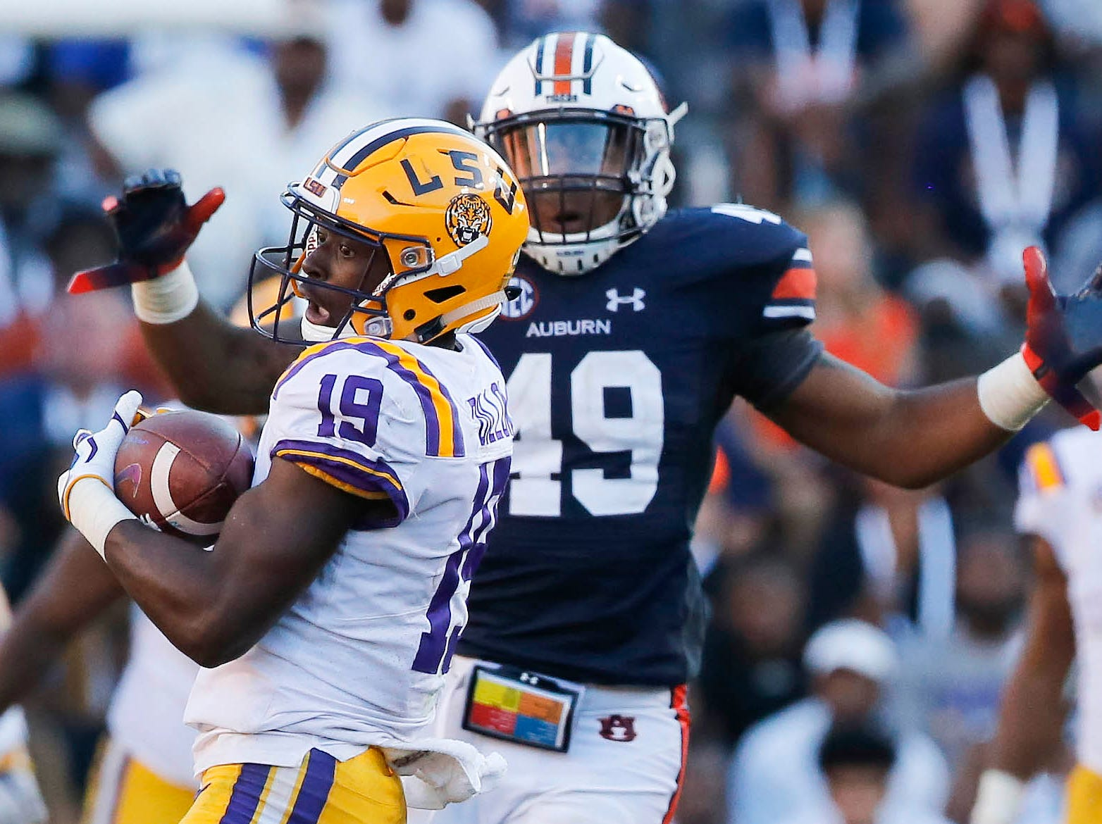 Sep 15, 2018; Auburn, AL, USA; LSU Tigers receiver Derrick Dillon (19) catches a pass over Auburn Tigers linebacker Darrell Williams (49) during the fourth quarter at Jordan-Hare Stadium. Mandatory Credit: John Reed-USA TODAY Sports