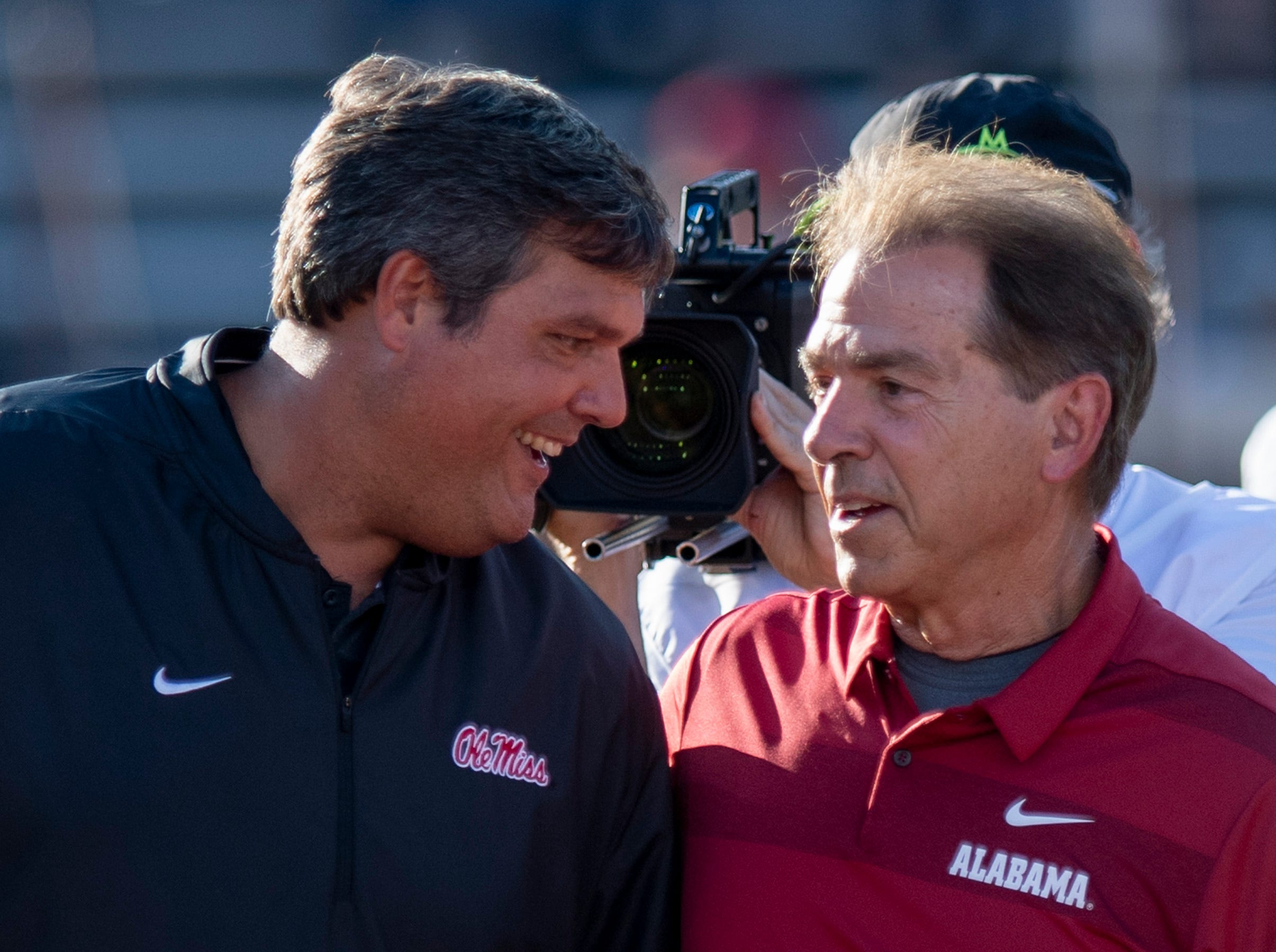 Ole Miss head coach Matt Luke and Alabama head coach Nick Saban greet during warm ups before the Ole Miss game in Oxford, Ms., on Saturday September 15, 2018.