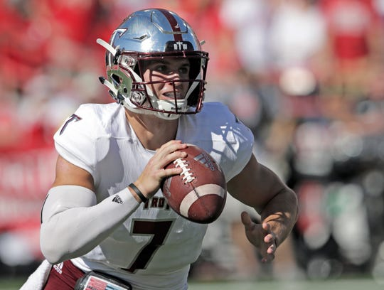 Troy quarterback Kaleb Barker (7) carries the ball during the first half of an NCAA college football game against Nebraska in Lincoln, Neb., Saturday, Sept. 15, 2018. (AP Photo/Nati Harnik)