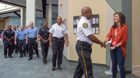Montgomery firefighters arrive at a brunch recognizing the volunteers and first responders who helped during and after the Booker T. Washington fire.