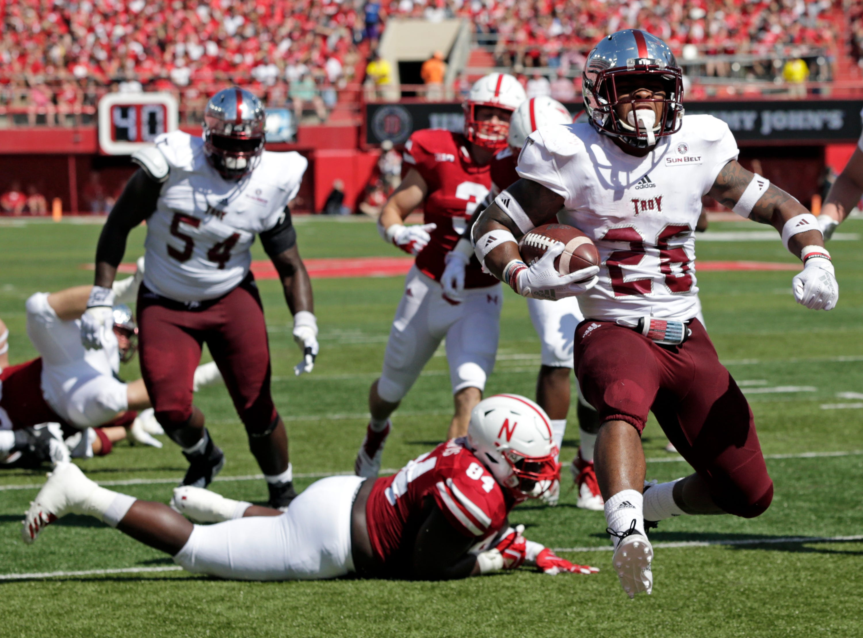 Troy running back B.J. Smith (26) runs into the end zone past Nebraska defensive lineman Khalil Davis (94) during the first half of an NCAA college football game in Lincoln, Neb., Saturday, Sept. 15, 2018. (AP Photo/Nati Harnik)
