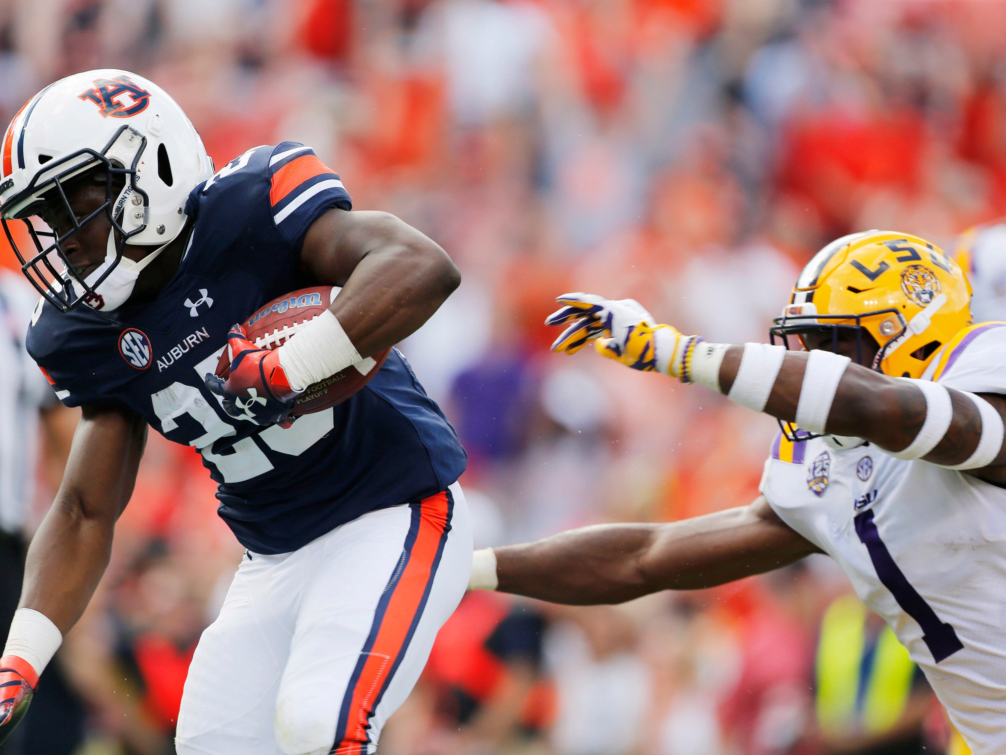 Sep 15, 2018; Auburn, AL, USA; Auburn Tigers running back Shaun Shivers (25) gets past LSU Tigers cornerback Kelvin Joseph (1) and scores a touchdown during the second quarter at Jordan-Hare Stadium. Mandatory Credit: John Reed-USA TODAY Sports