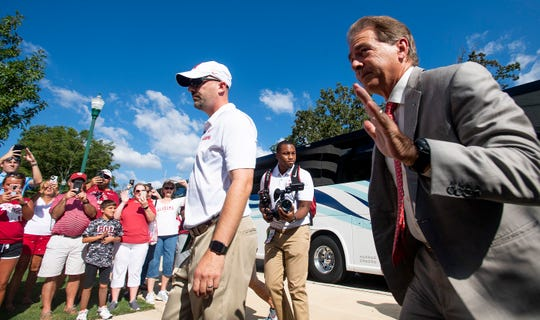 Alabama head coach Nick Saban greets fans as the Alabama football team arrives on the Ole Miss campus in Oxford, Ms., on Saturday September 15, 2018.