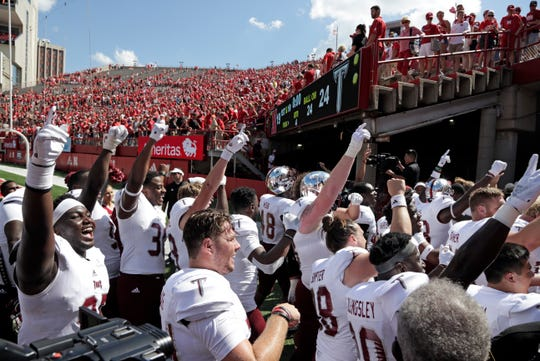 Troy players celebrate after a win over Nebraska in Lincoln, Neb., Saturday, Sept. 15, 2018.