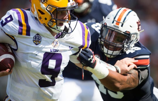 LSU's Joe Burrow (9) stiff arms Auburn's Darrell Williams (49) at Jordan-Hare Stadium in Auburn, Ala., on Saturday, Sept. 15, 2018. Auburn leads LSU 14-10 at halftime.