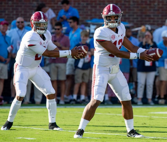Alabama quarterback Tua Tagovailoa (13) and quarterback Jalen Hurts (2) as the Alabama football team warms up before the Ole Miss game in Oxford, Ms., on Saturday September 15, 2018.