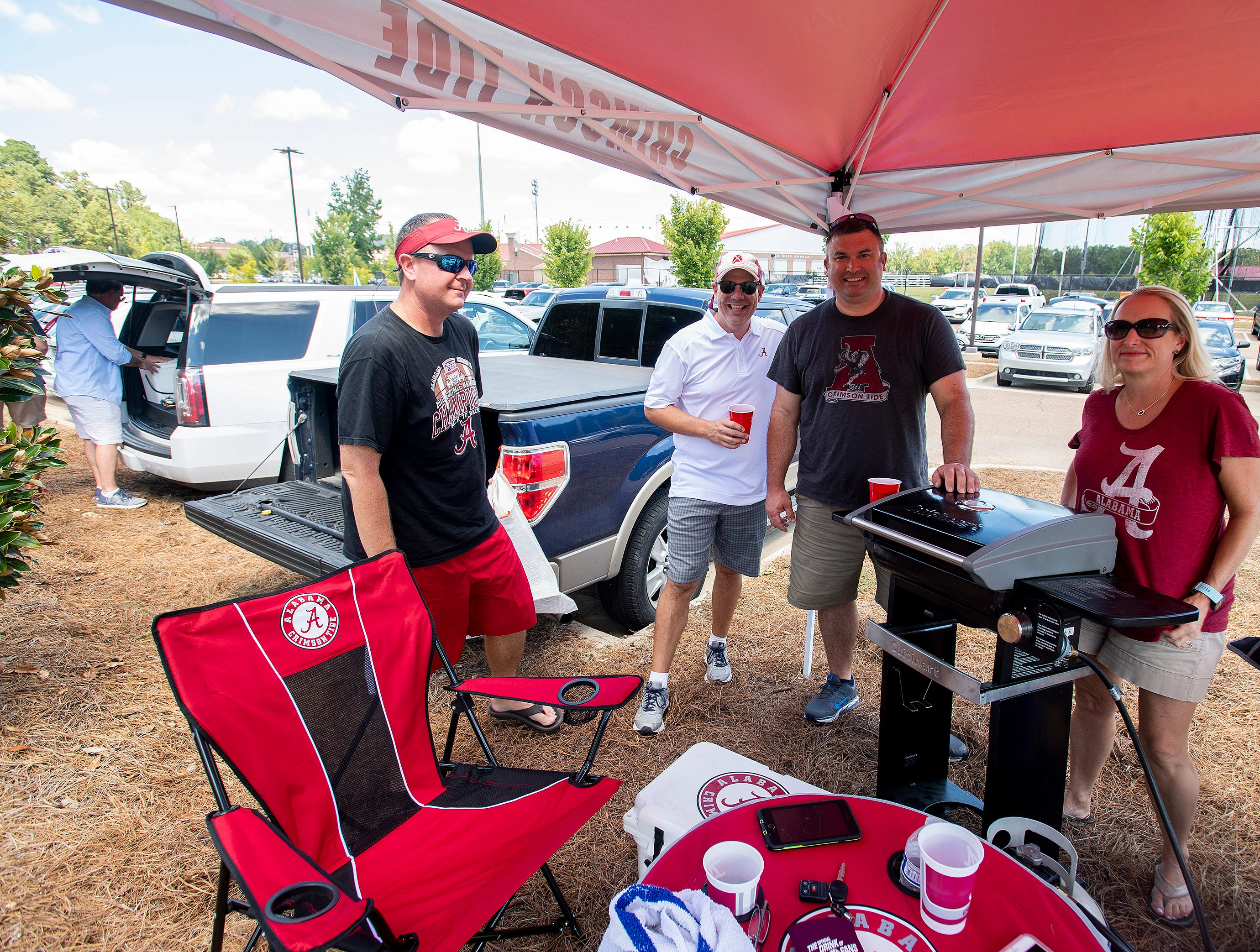 Alabama fans, from left, Jimmy Carlton, Jimmy Moore, Chad Wright and Rebecca Carlton tailgate before the game on the Ole Miss campus in Oxford, Ms., on Saturday September 15, 2018.