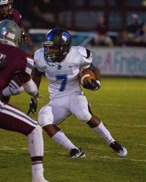 Montgomery Catholic's Darrell Gibson runs the ball during the first drive of the game against Alabama Christian.