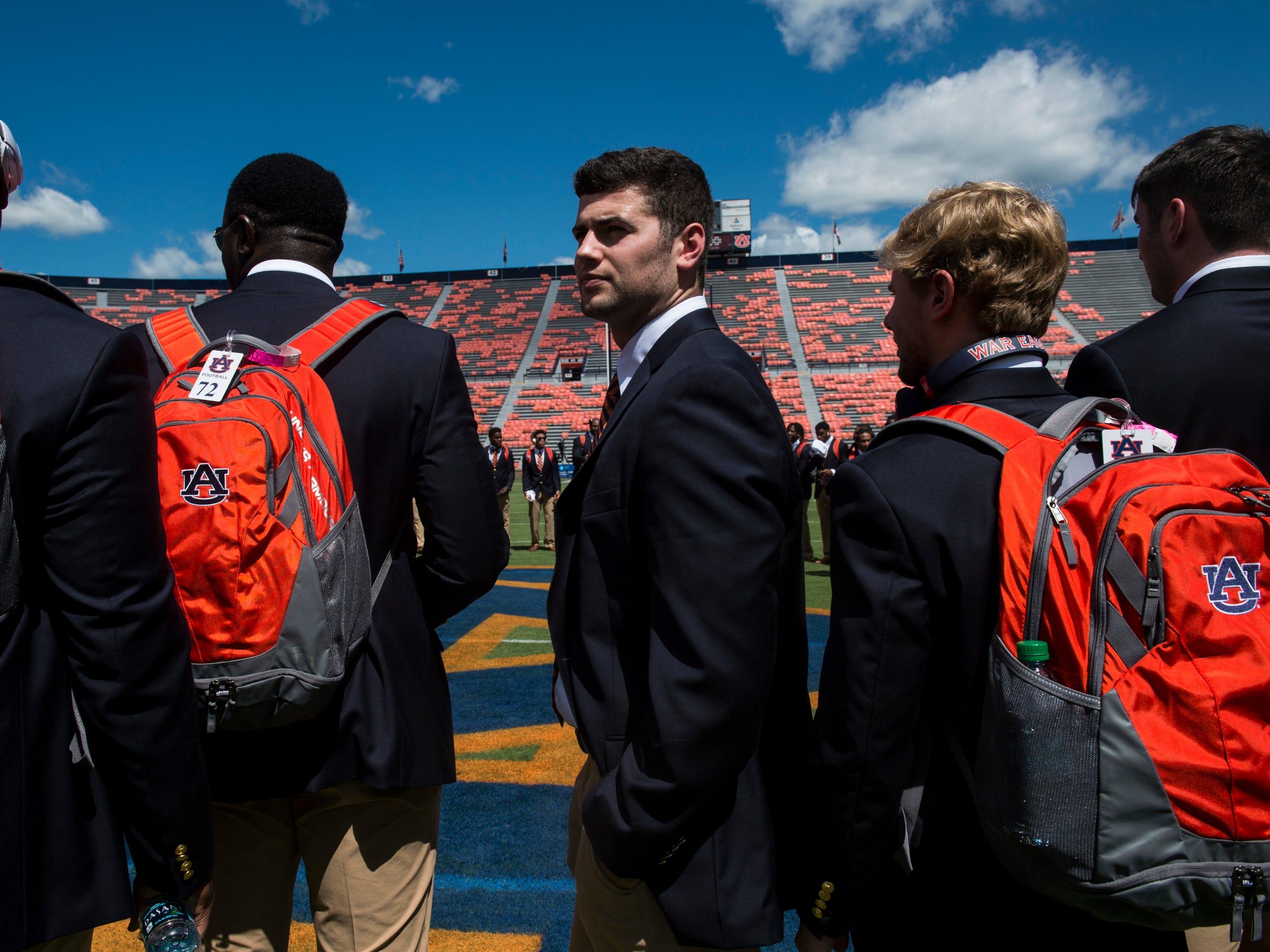 Auburn's Jarrett Stidham (8) huddles with his team after the Tiger Walk at Jordan-Hare Stadium in Auburn, Ala., on Saturday, Sept. 15, 2018.