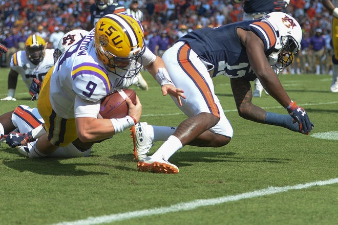 Sep 15, 2018; Auburn, AL, USA; LSU Tigers quarterback Joe Burrow (9) comes up just short of the goal line on a carry during the first quarter against the Auburn Tigers at Jordan-Hare Stadium. Mandatory Credit: Julie Bennett-USA TODAY Sports