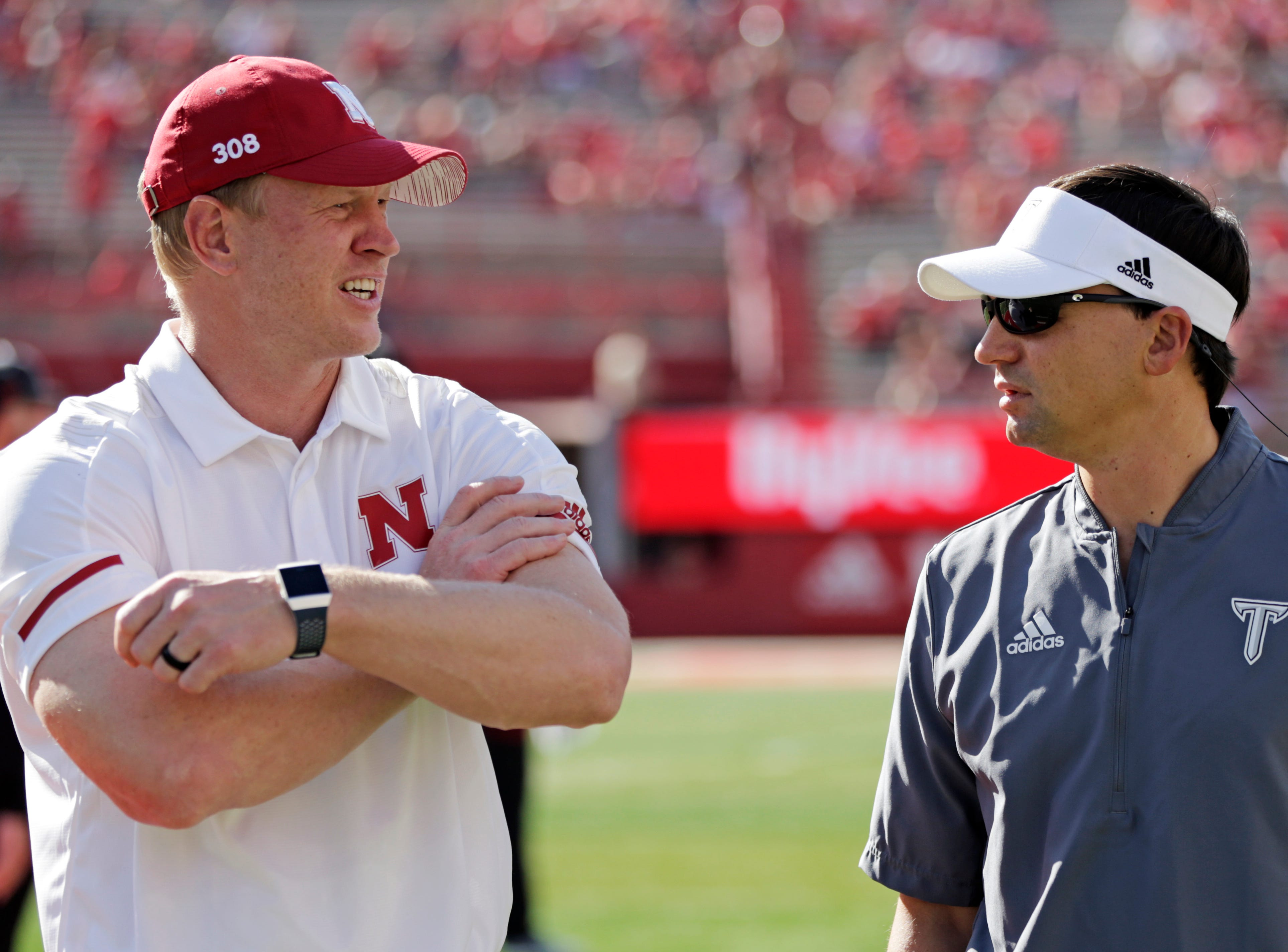 Nebraska head coach Scott Frost, left, chats with Troy head coach Neal Brown before an NCAA college football game in Lincoln, Neb., Saturday, Sept. 15, 2018. (AP Photo/Nati Harnik)