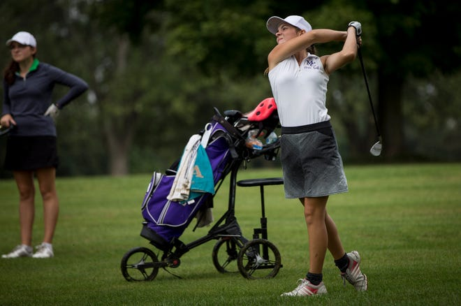 Central's Teddi Bishop attempts her shot during the girls golf sectional on Sept. 15 at Crestview Golf Club.