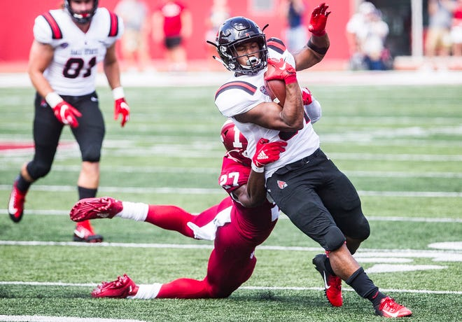 Ball State's James Gilbert slips away from Indiana's defense for a touchdown during their game at Memorial Stadium in Bloomington Saturday, Sept. 15, 2018.