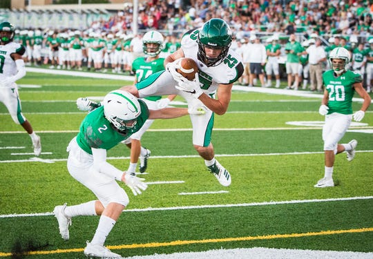 Yorktown's Austin Hill catches for a touchdown against New Castle during their game at New Castle High School Friday, Sept. 14, 2018.