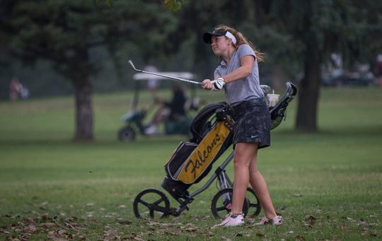 Winchester's Becca Chamberlin makes her shot during the girls golf sectional on Sept. 15 at Crestview Golf Club.