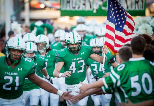 New Castle faces off against Yorktown during their game at New Castle High School Friday, Sept. 14, 2018.