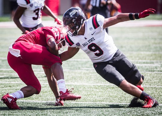 Ball State's Brandon Martin stops a run by Indiana  during their game at Memorial Stadium in Bloomington Saturday, Sept. 15, 2018.