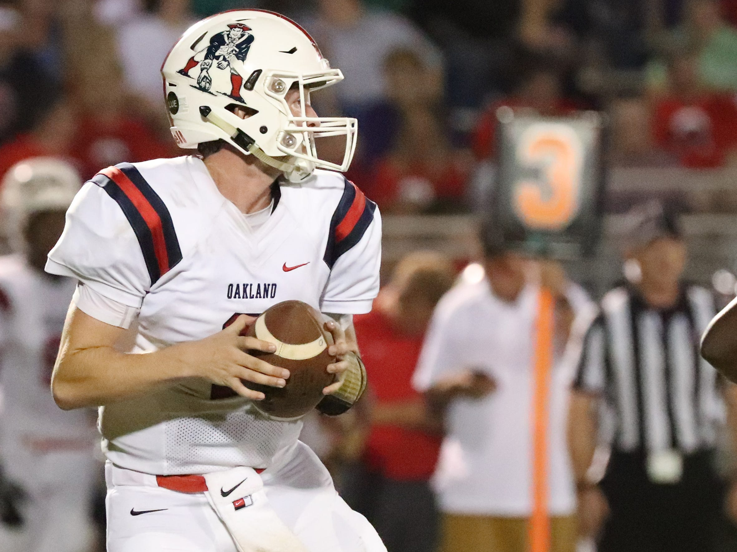 Oakland's quarterback Brevin Linnell (2) drops back to pass the ball against Riverdale during the Battle of the Boro on Friday, Sept. 14, 2018.
