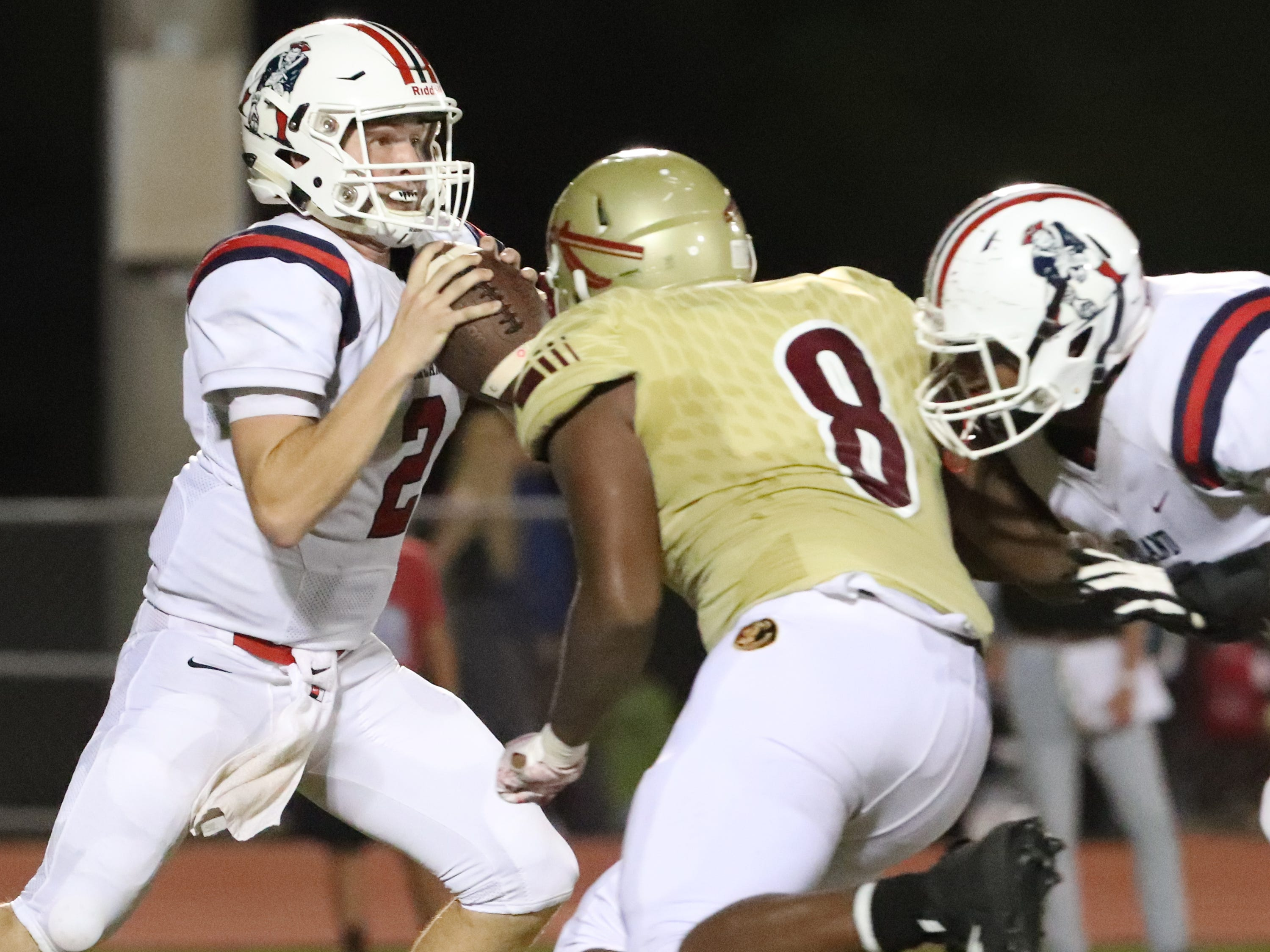 Oakland's quarterback Brevin Linnell (2) drops back to pass the ball as Riverdale's Samari Hill (8) puts on the pressure during the Battle of the Boro on Friday, Sept. 14, 2018.