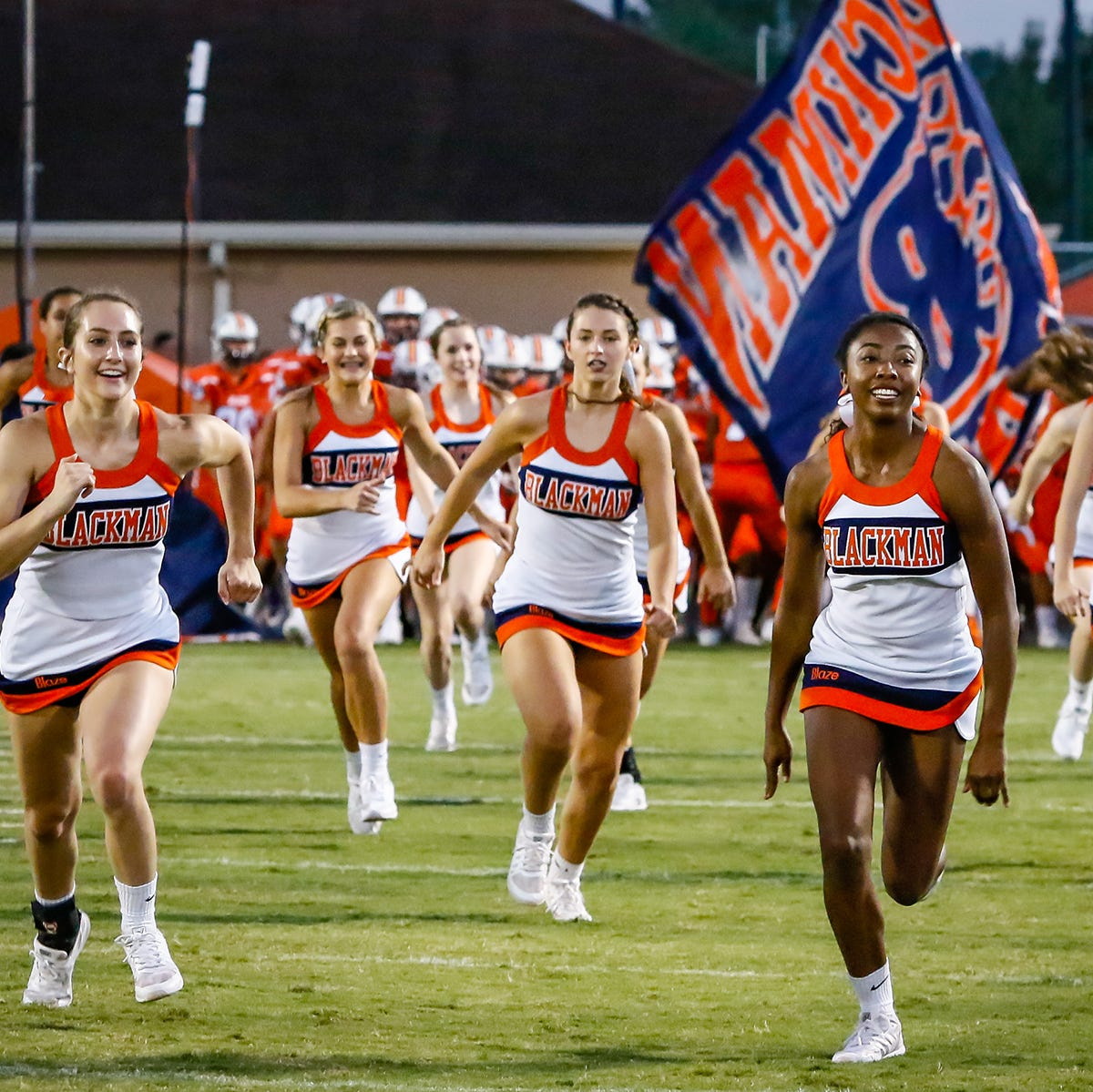 Blackman cheerleaders lead the pack prior to Friday's game vs. Siegel.