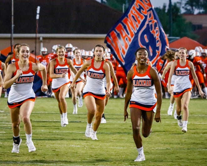 Blackman cheerleaders lead the team out prior to last week's game against Siegel. The Blaze play at Oakland Friday.