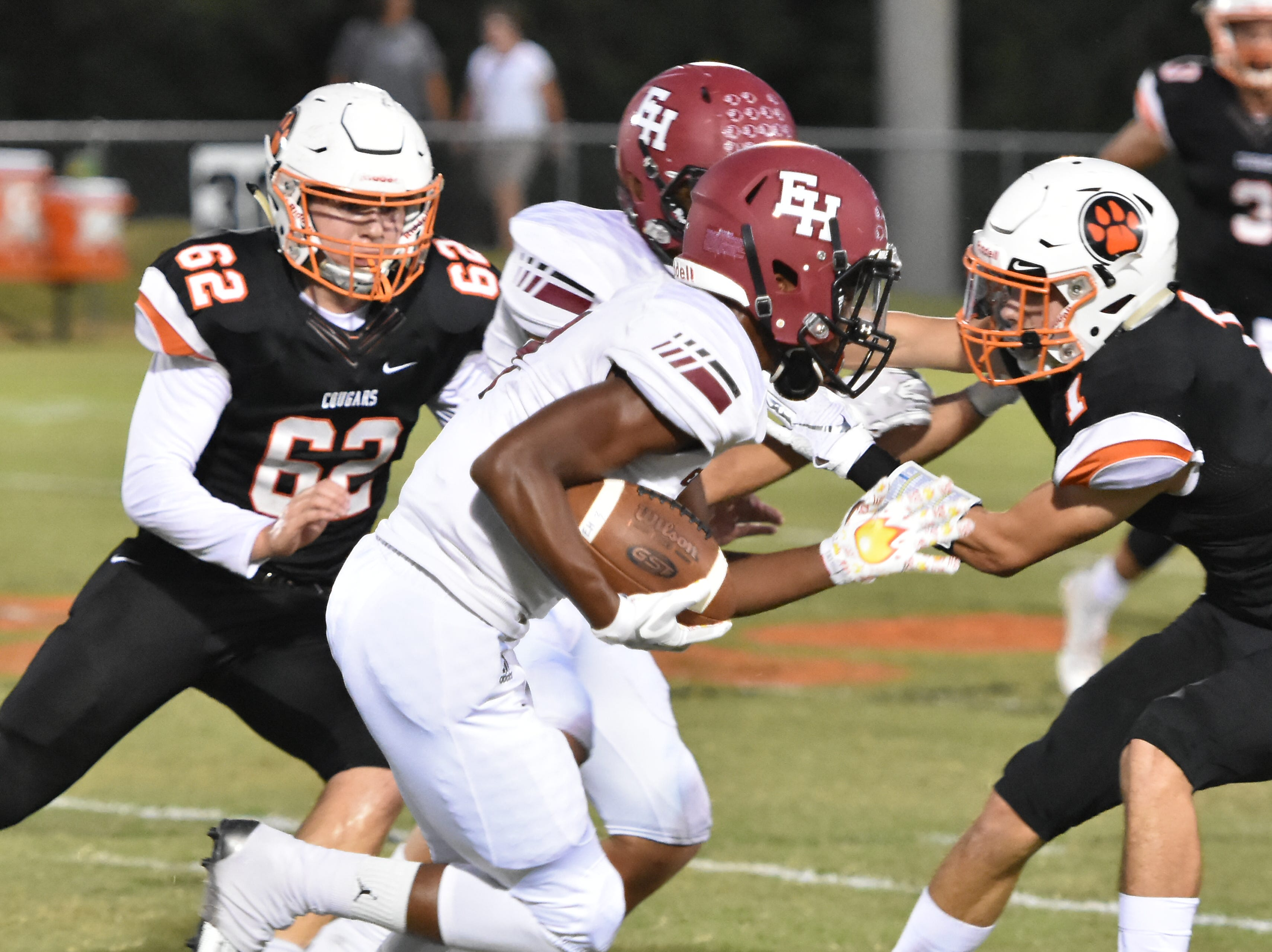 Ezell-Harding's Braxton Coleman rushes against MTCS Friday night.