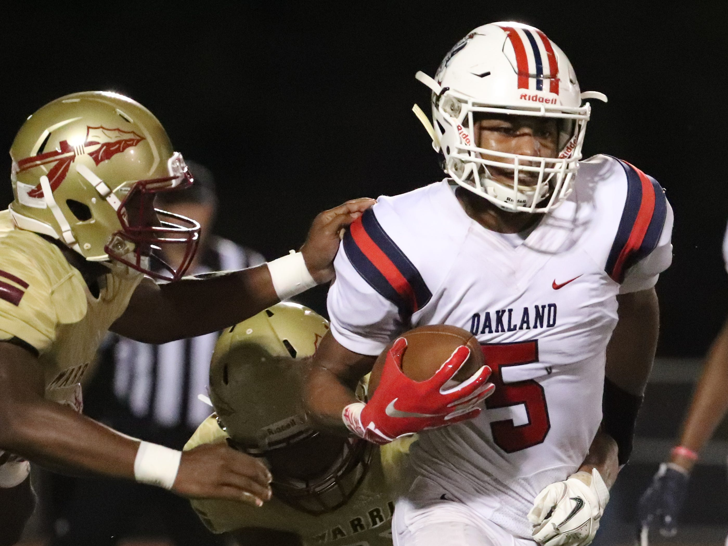 Oakland's Woodi Washington (5) runs the ball against Riverdale, at Riverdale, during the Battle of the Boro on Friday, Sept. 14, 2018.
