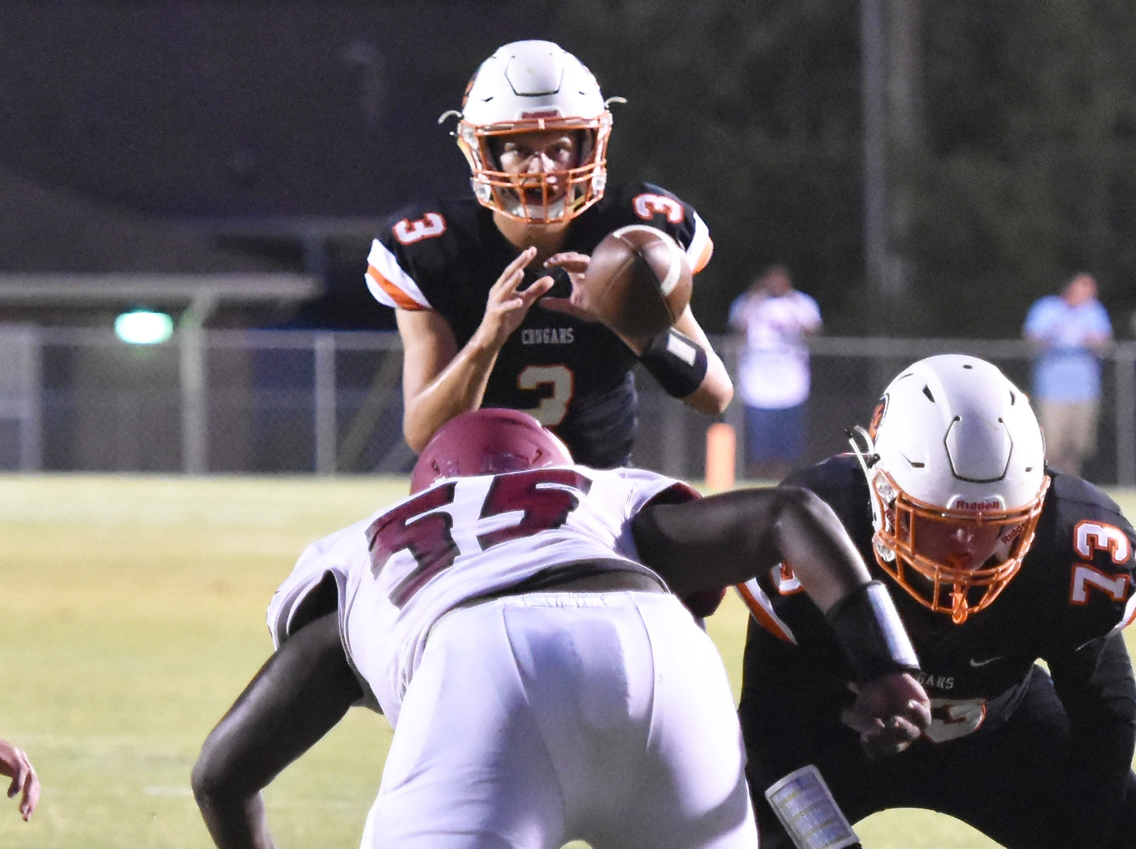 MTCS QB Jackson Green takes a snap from center against Ezell-Harding Friday night.