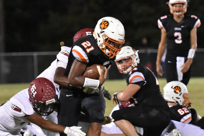 Kemari McGowan of MTCS tries to break a tackle Friday night against Ezell-Harding.