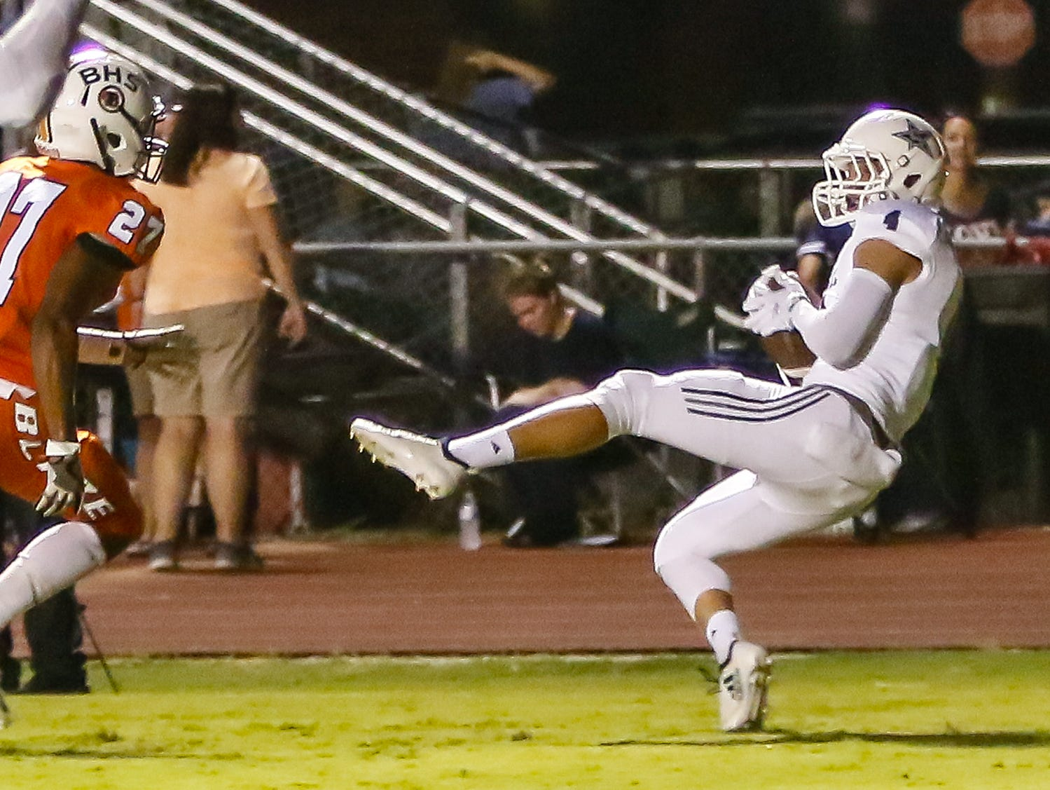 Siegel's Evan Milligan catches a TD pass in the end zone.