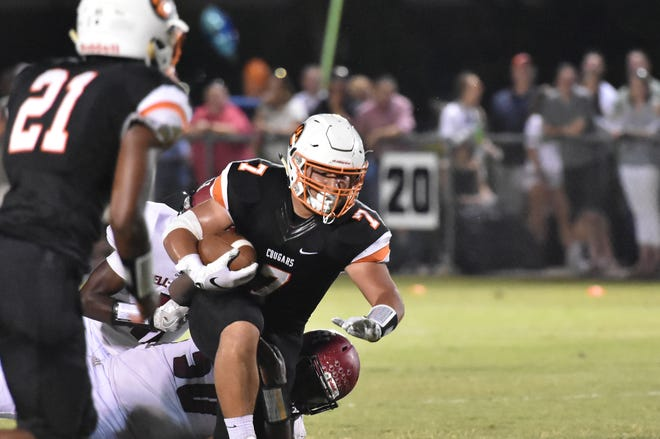 MTCS' Drew Berry is brought down during a recent game. Berry exploded for 353 yards and six touchdowns for the Cougars on Friday.