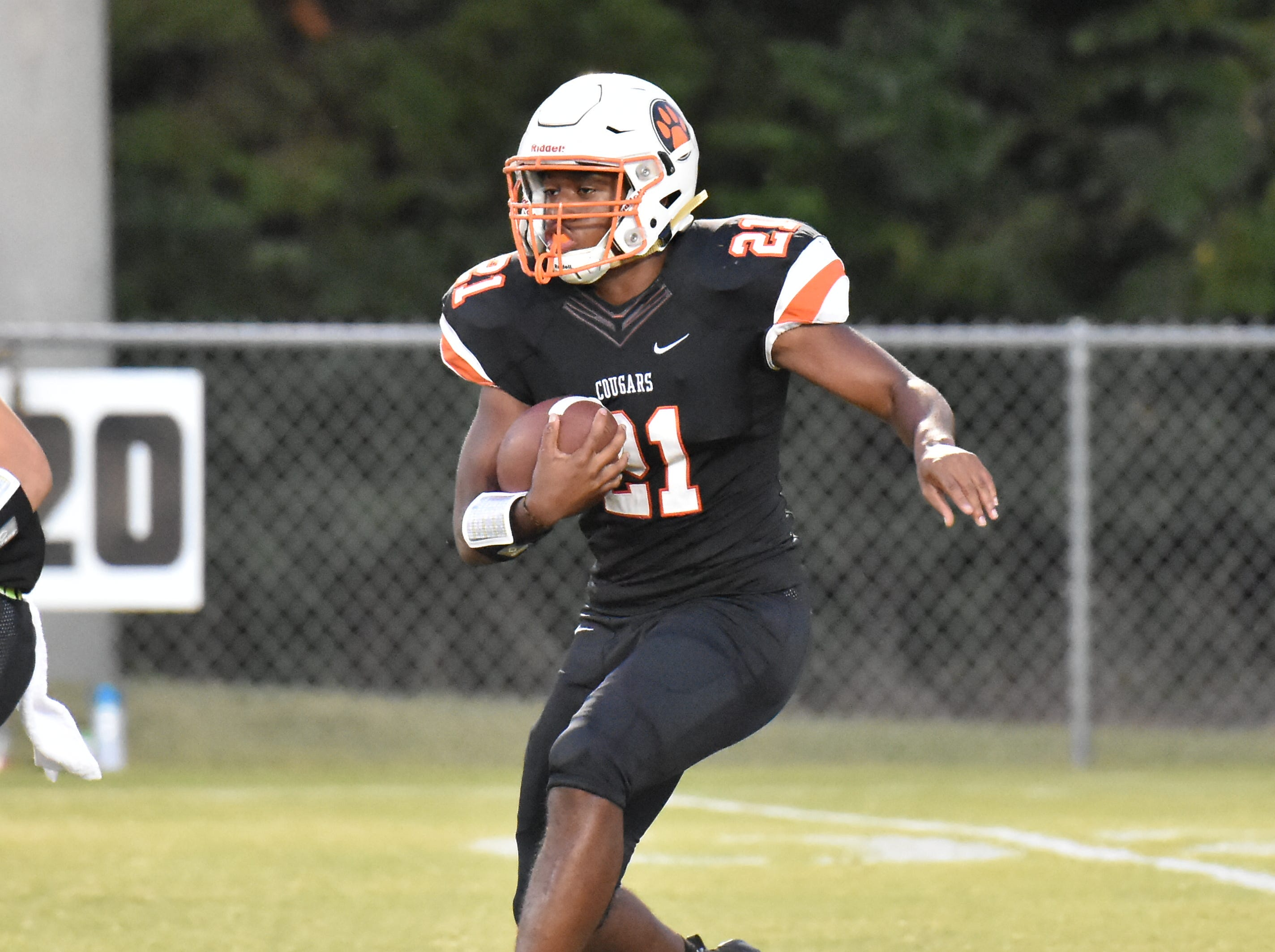 MTCS running back Kemari McGowan carries the ball against Ezell-Harding Friday night in Murfreesboro.