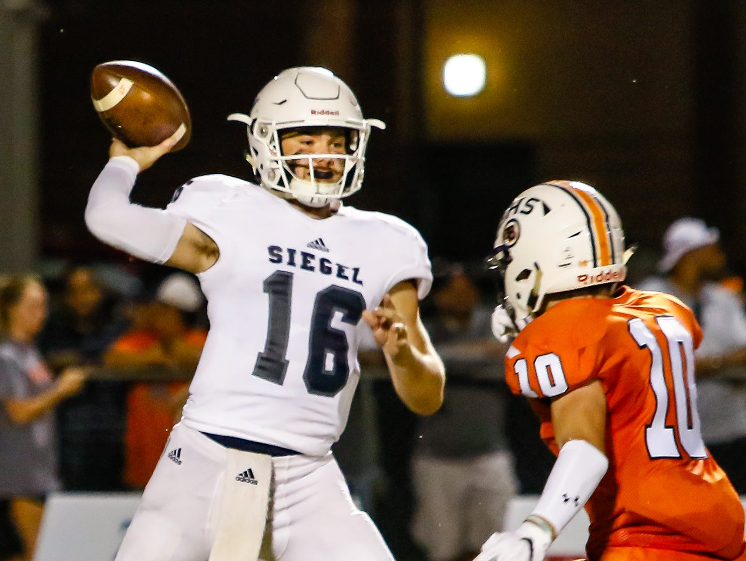 Siegel quarterback Tucker Sears release the ball just before being hit by Blackman's Matthew Hall.
