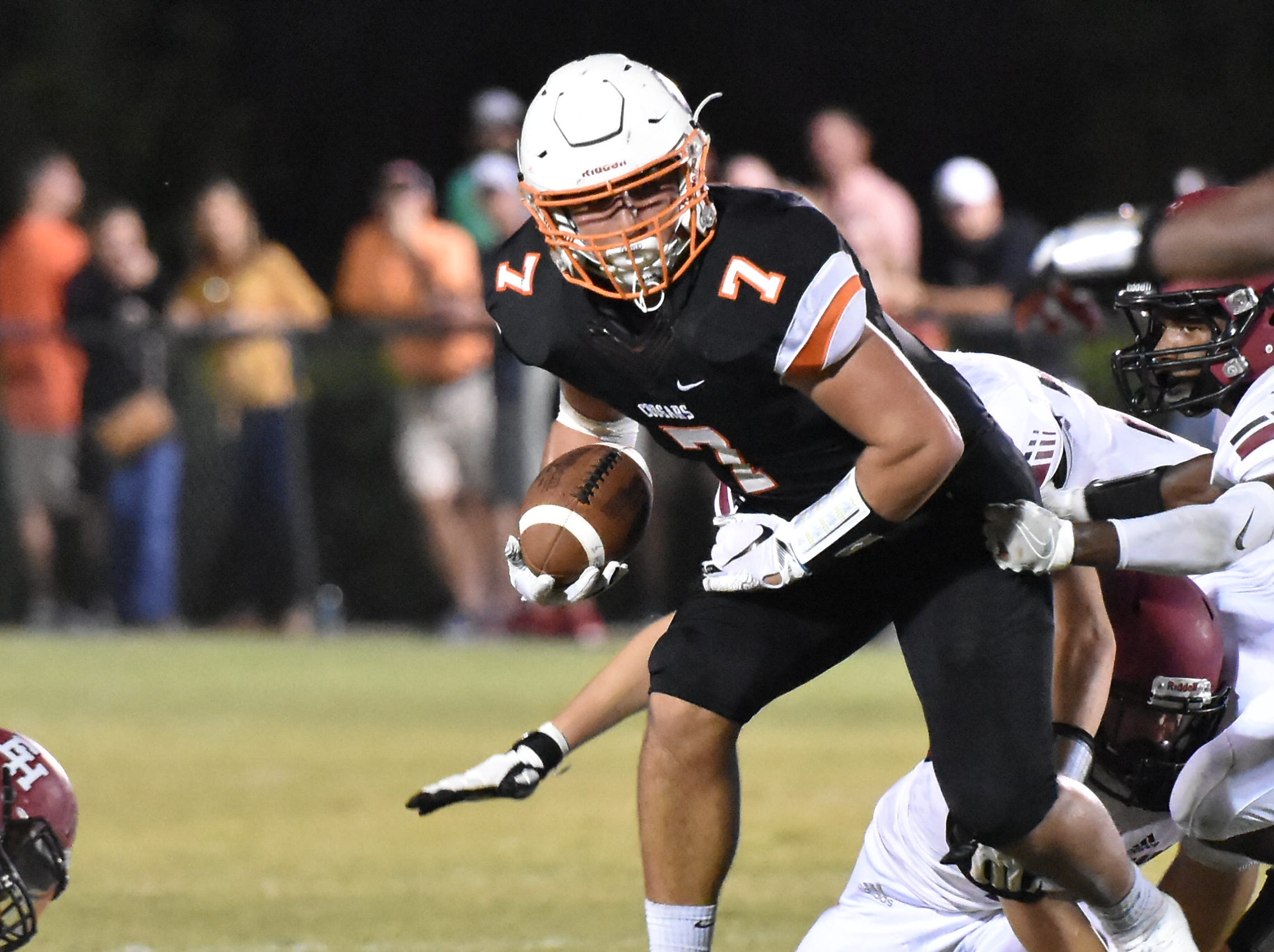 MTCS's Drew Berry tries to break loose Friday night against Ezell-Harding.