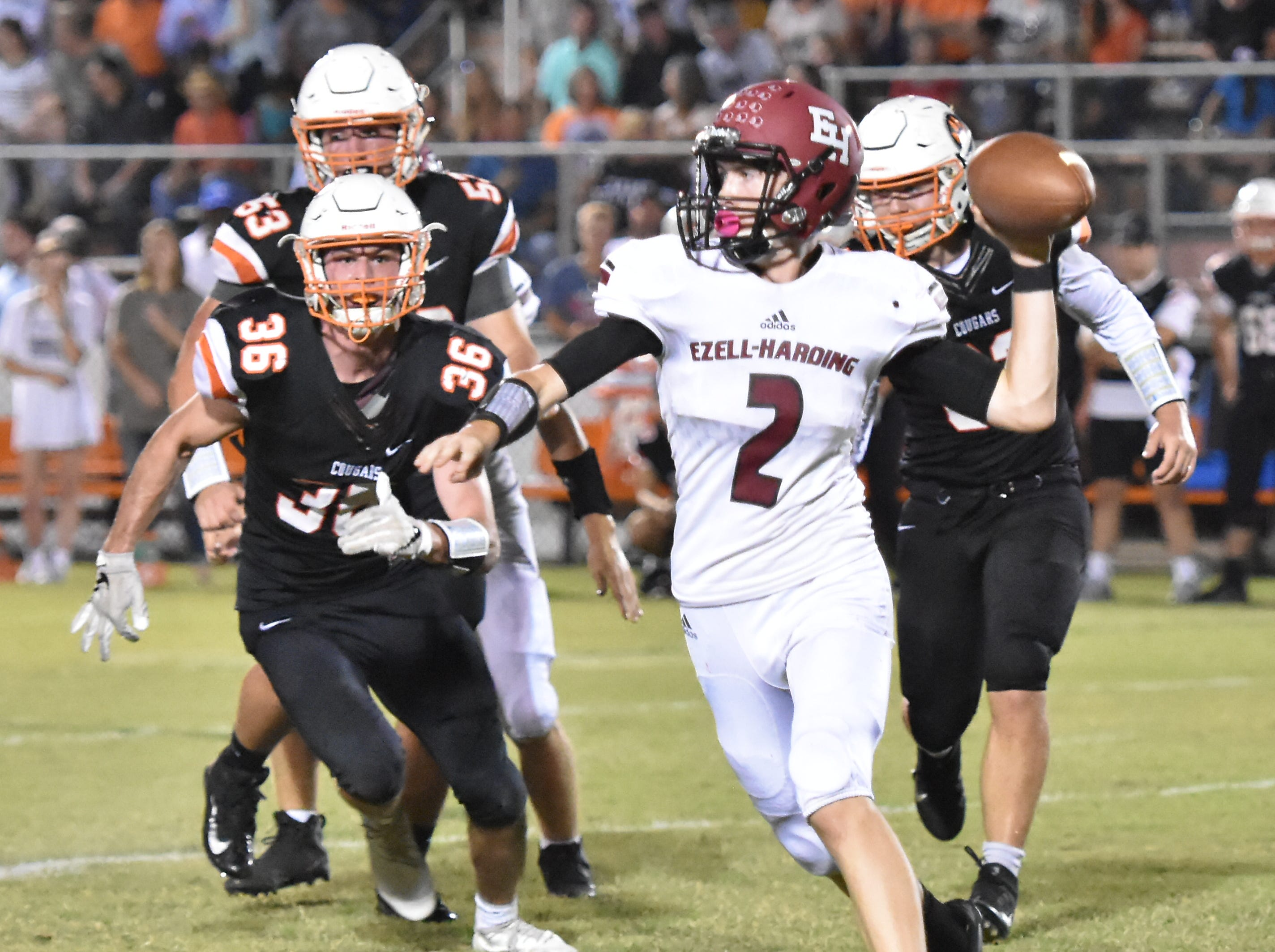 Ezell-Harding QB Derek Griffin prepares to throw a pass against MTCS Friday night.