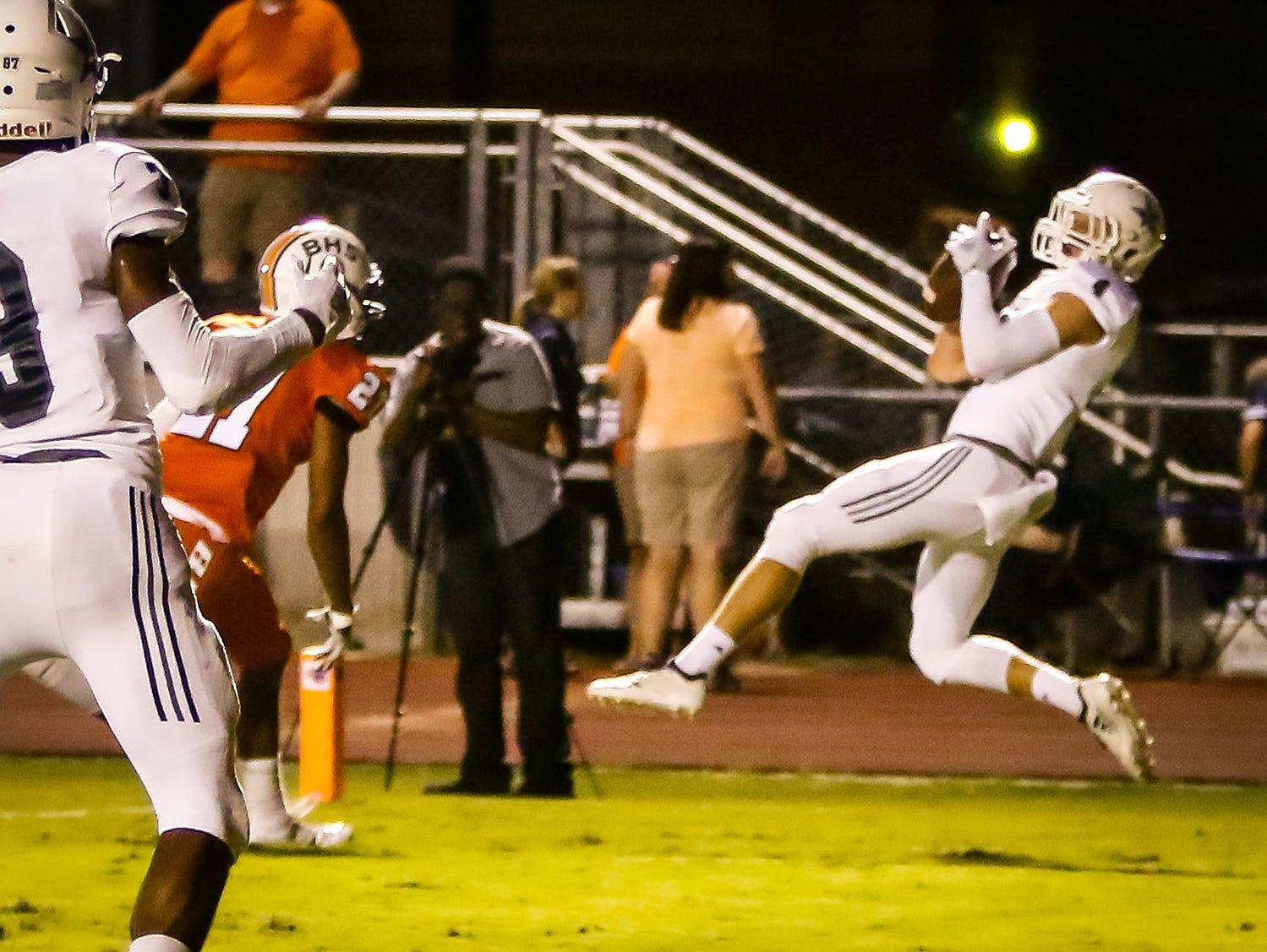 Siegel's Evan Milligan hauls in a touchdown pass during Friday's game at Blackman.