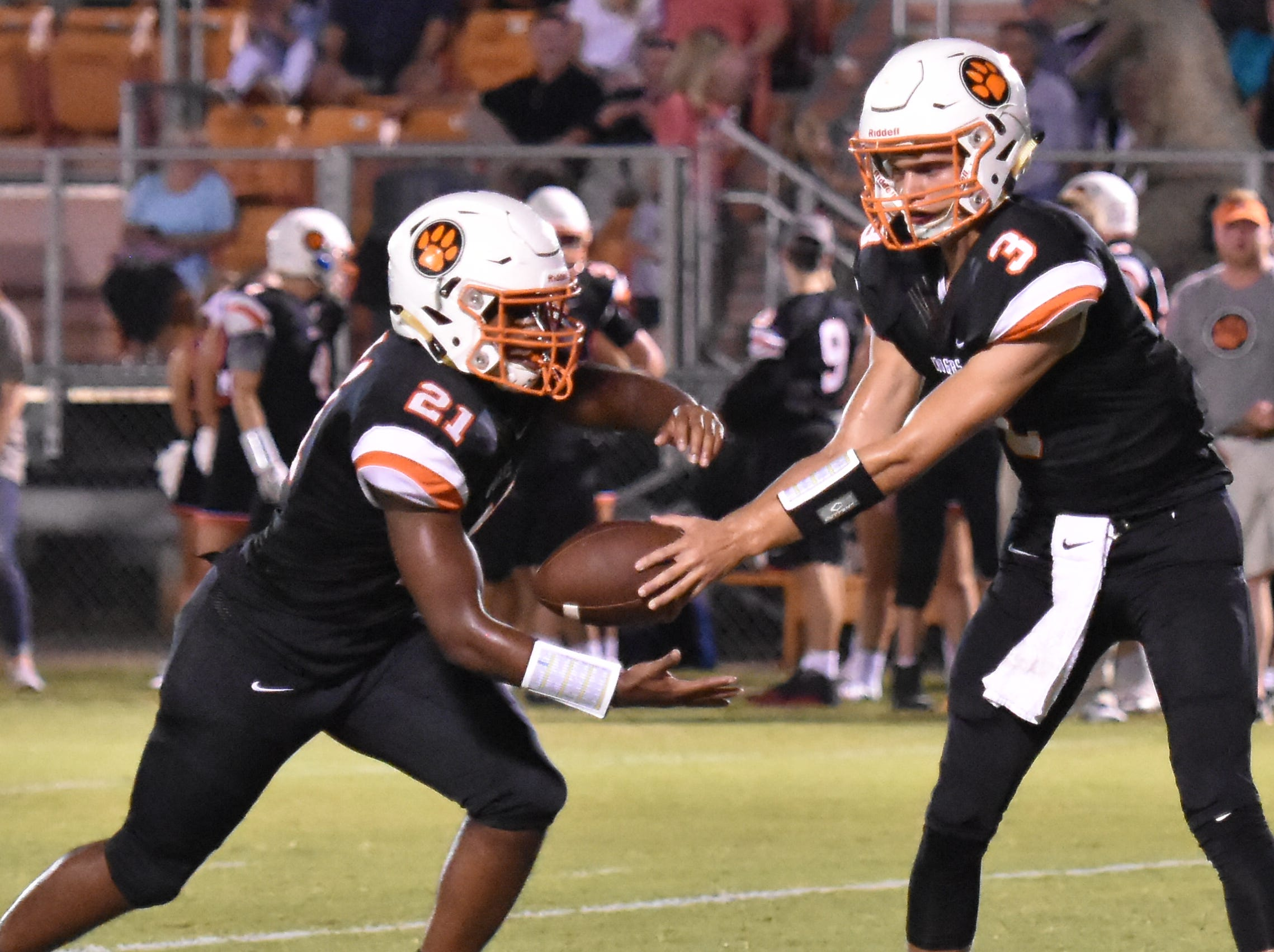 MTCS QB Jackson Green hands off to running back Kemari McGowan against Ezell-Harding Friday night.