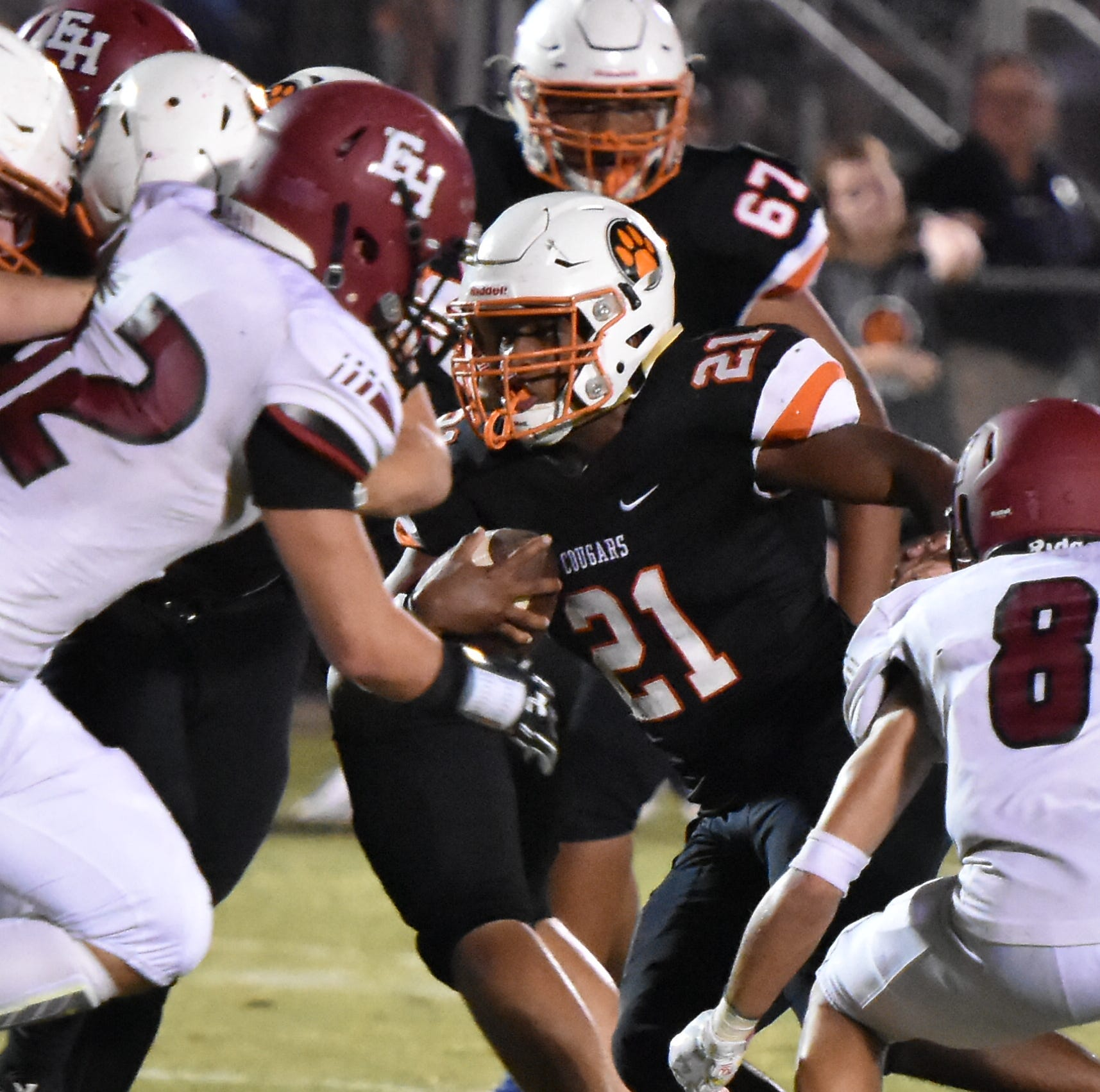 MTCS running back Kemari McGowan rushes against Ezell-Harding Friday night.