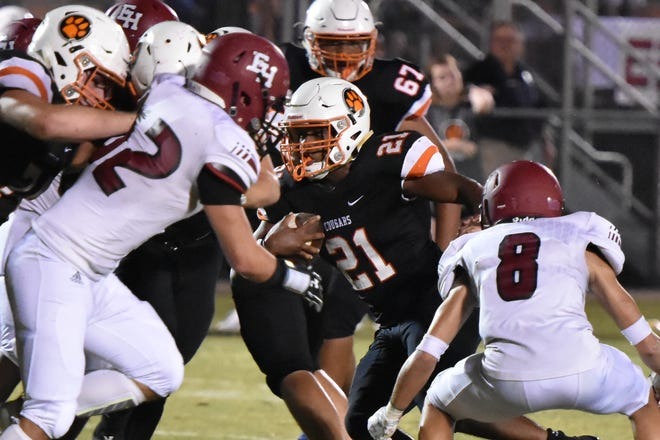 MTCS running back Kemari McGowan gains yardage during Friday's win over Ezell-Harding. McGowan was voted area boys athlete of the week for Sept. 10-15.