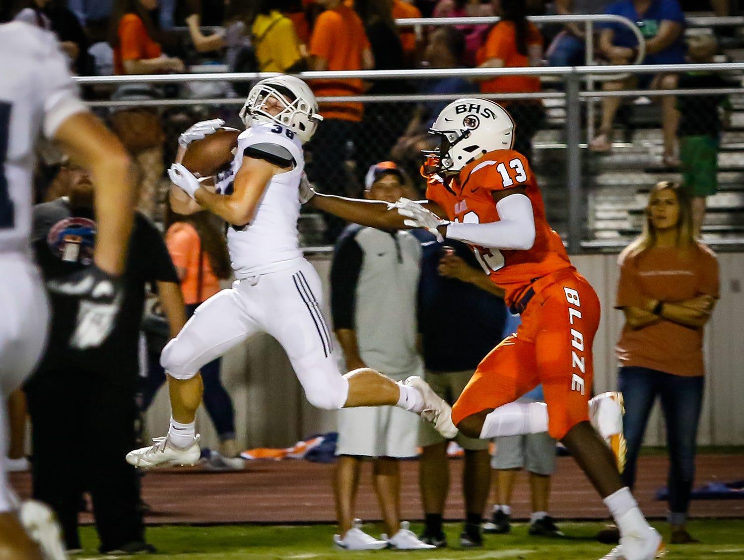 Siegel's Brandon Ricks intercepts a pass intended for Trey Knox.